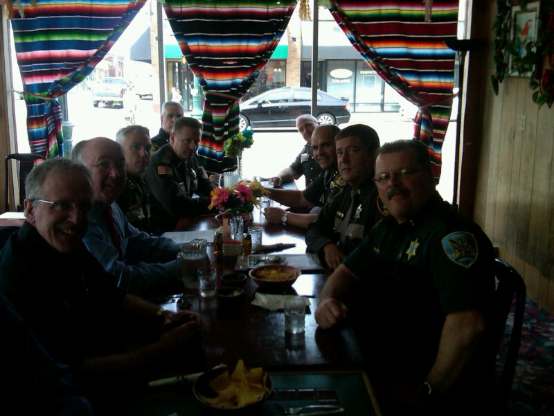 From Left clockwise around the table, (Lewis County Sheriff Steve Mansfield, Grays Harbor County Sheriff Mike Whelan,Thurston County Sheriff John Snaza, Mason County Sheriff Casey Salisbury,Mason County Chief Deputy Osterhut,Mason County Undersheriff Barrett,Thurston County Undersheriff Braniff,Pacific County Sheriff Scott Johnson and Grays Harbor County Undersheriff Rick Scott).